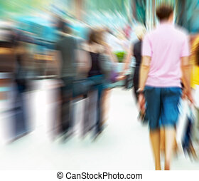 People rush on crowded street Motion blur