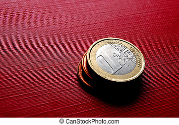 Coins EURO - Euro coins on red surface