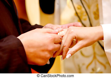 Wedding ceremony, Groom put a ring on bride hand