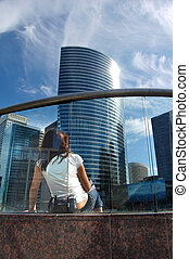 Prospect - Woman looking on skyscrapers. Prospect concept