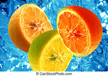 Fresh citrus background - Fresh halves of citrus fruits on...