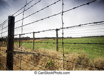 Barbed wire fence to prison - Barbed wire fence. Old prison