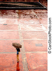 Alone in the rain - Woman with umbrella standing in rainy...