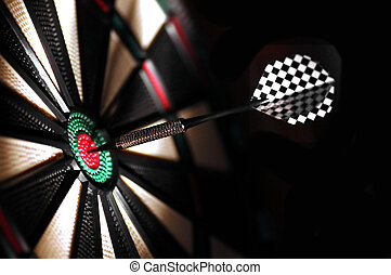 One arrow in the centre of a dart board. Shallow depth of...
