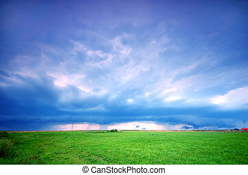 Stormy landscape - Grassland and stormy rainy sky. Ideal as...