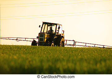 Spraying the Crop. Focus on tractor