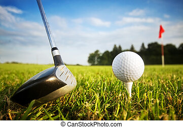 Playing golf. Club and ball on tee - Playing golf. Golf club...