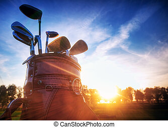 Golf gear, clubs at sunset - Professional golf gear on the...