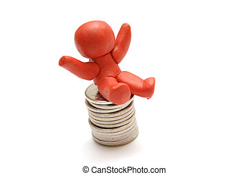 BUSINESS WINNER - Plasticine figure sitting on coins pile...