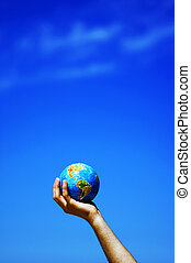 Earth globe in hands. Conceptual image - Earth globe in hand...