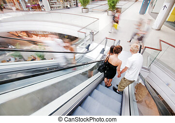 Couple shopping in mall - Couple doing shopping in a mall