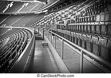 Empty football, soccer stadium grandstand in black and white