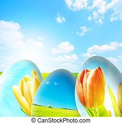 Perfect easter background. Colorful easter eggs and blue sky