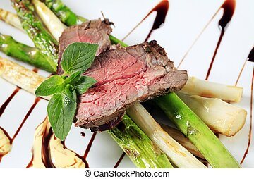 Roast beef and asparagus - Slices of roast beef and...