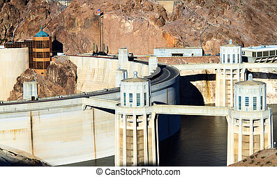 Hoover Dam - A side view of the Hoover Dam which borders...