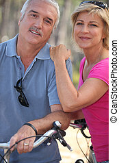 Married couple enjoying bike ride