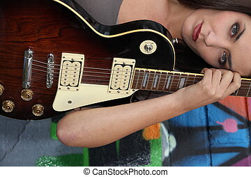 Closeup of a female guitarist