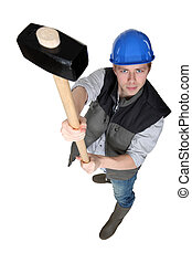 Construction worker holding a loft a sledgehammer