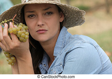 Woman holding grapes