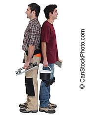 craftsman and apprentice standing back to back