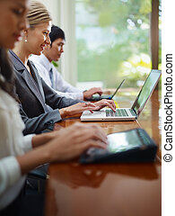business man and women typing on pc during meeting - Group...