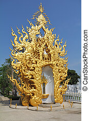 The chapel ornated by gold in the White Palace. Thailand