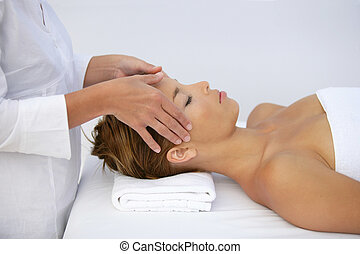 Woman being given head-massage