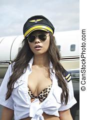 Beautiful Asian pilot woman - Sexy Asian woman in flight...