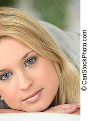 close-up of a young pretty blonde's face