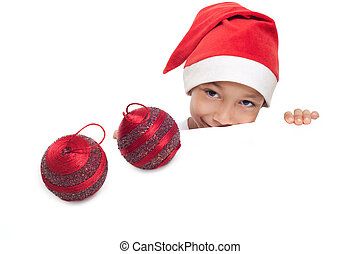 boy in red hat with two christmas balls