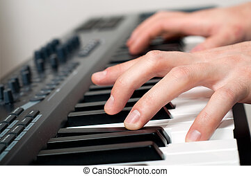 male hands playing the piano