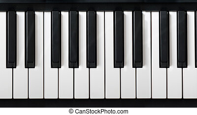 electronic piano keyboard closeup with black and white piano...