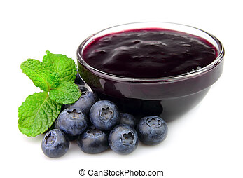 Jam jar with blueberry and mint on white background