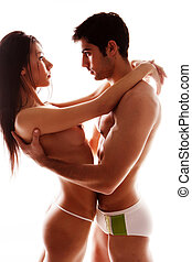 Couple in Underwear Cuddling - Young attractive brunette...