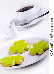 St Patrick's cookie with green icing on a plate