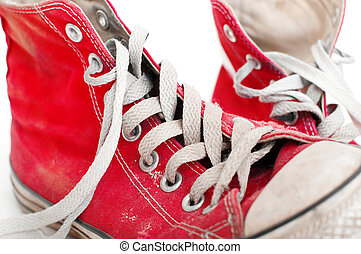 old red shoes on a white background