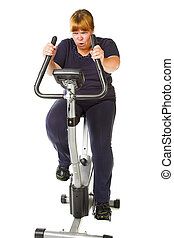 fat woman fitnes - tired fat woman training on the bike