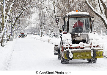 snow removal a small tractor in the park - winter snow...