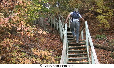 Fall stairs Timelapse - A young man climbs up and then comes...