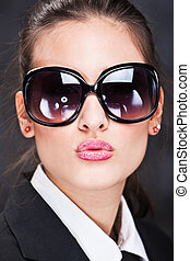 girl with big sun glasses sending kiss