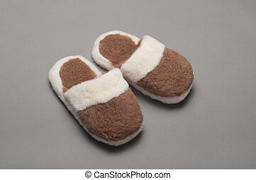 slippers made of camel hair with a gray background