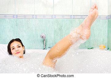 woman enjoy bath foam in the bathtub