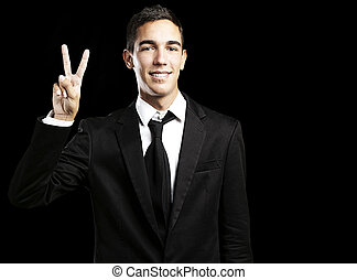 young man - portrait of handsome young man doing good symbol...