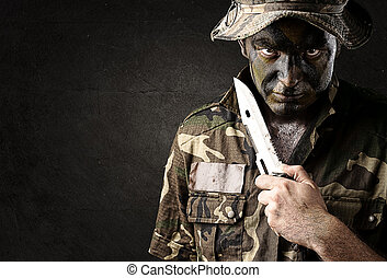 young soldier - portrait of young soldier threatening to...