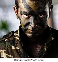 soldier face - portrait of young soldier face over abstract...