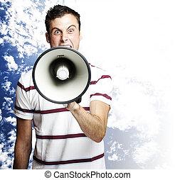 man shouting - portrait of young man shouting using...