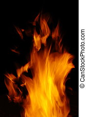 Dance of fire - Tongue of orange flame isolated on black...