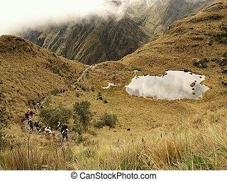 Tourists climbing the Inca trail