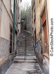 Old alley with stairs - An alley with stairs of the old...