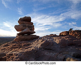 Cairn - A pile of small rocks marks a trail across desert...